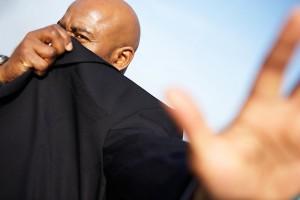 man hiding face